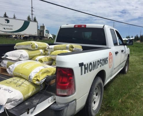 Thompsons delivering soybean seed to customer field